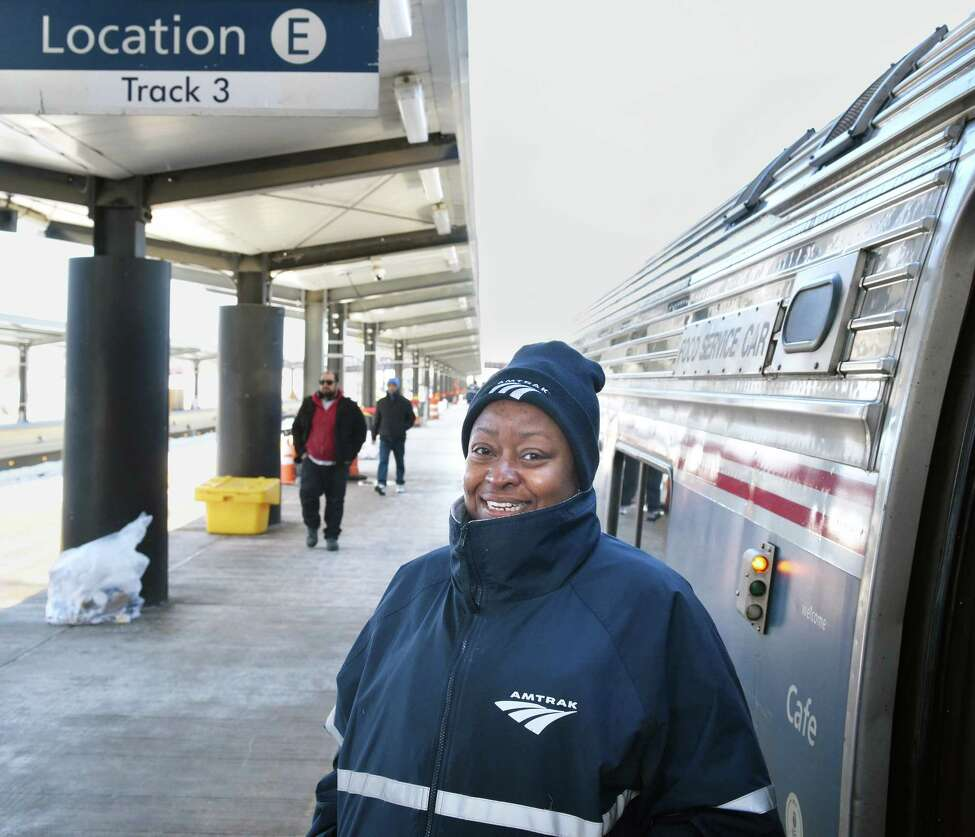 Sleeping car attendant Dollicia Bell of Chicago helps passengers on the newly extended station platform board the Lake Shore Limited at the Rensselaer Amtrak station Friday March 17, 2017 in Rensselaer, NY. (John Carl D'Annibale / Times Union)