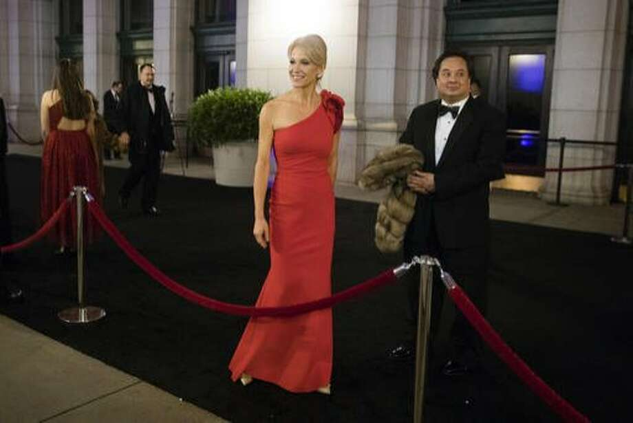 In this 2017 photo, Trump adviser Kellyanne Conway, center, accompanied by her husband, George, speaks with members of the media as they arrive for a dinner at Union Station in Washington, the day before Trump's inauguration. Photo: Matt Rourke, Associated Press