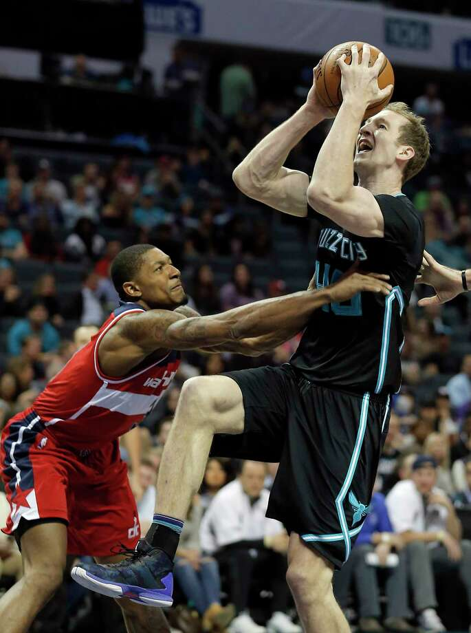 Washington Wizards' Bradley Beal, left, defends as Charlotte Hornets' Cody Zeller, right, tries to hit a basket during the first half of an NBA basketball game in Charlotte, N.C., Saturday, March 18, 2017. The Hornets won 98-93. (AP Photo/Bob Leverone) ORG XMIT: NCBL108 Photo: Bob Leverone / FR170480 AP