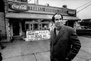 "An undated handout photo of Philip Roth revisiting the area in Newark where he grew up, in an archival photo that appears in a new documentary. The documentary ""Philip Roth: Unmasked,"" an essay in self-criticism screening at Film Forum in New York, will also be broadcast as part of the PBS series ""American Masters."" (Bob Peterson via The New York Times) -- NO SALES; FOR EDITORIAL USE ONLY WITH STORY SLUGGED ROTH FILM REVIEW. ALL OTHER USE PROHIBITED. --"