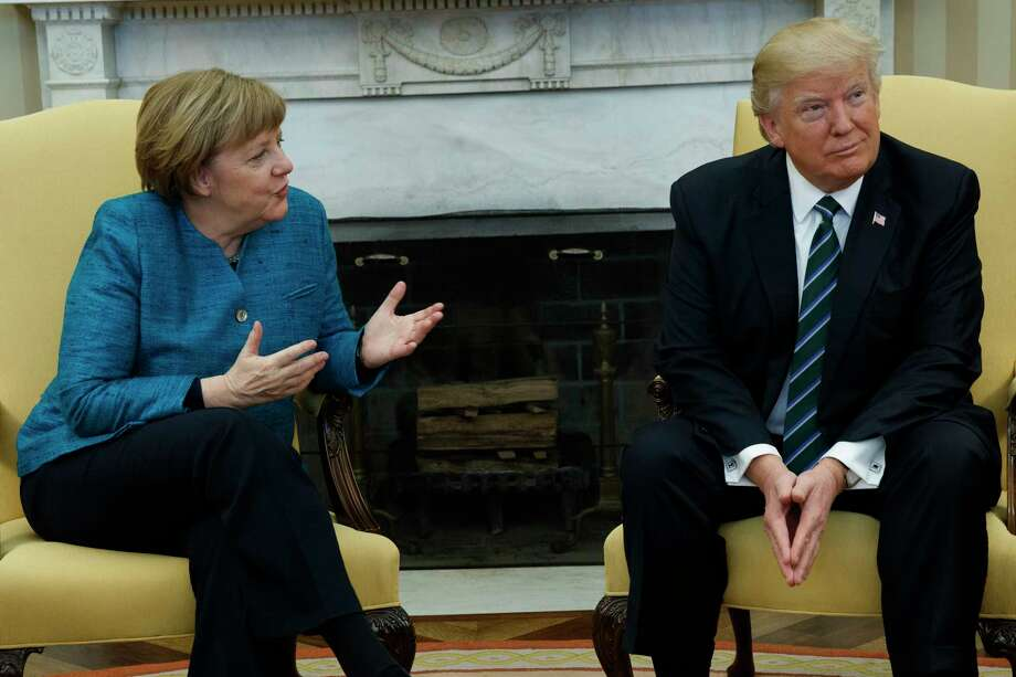 President Donald Trump meets with German Chancellor Angela Merkel in the Oval Office of the White House in Washington, Friday, March 17, 2017. (AP Photo/Evan Vucci) ORG XMIT: DCEV117 Photo: Evan Vucci / Copyright 2017 The Associated Press. All rights reserved.