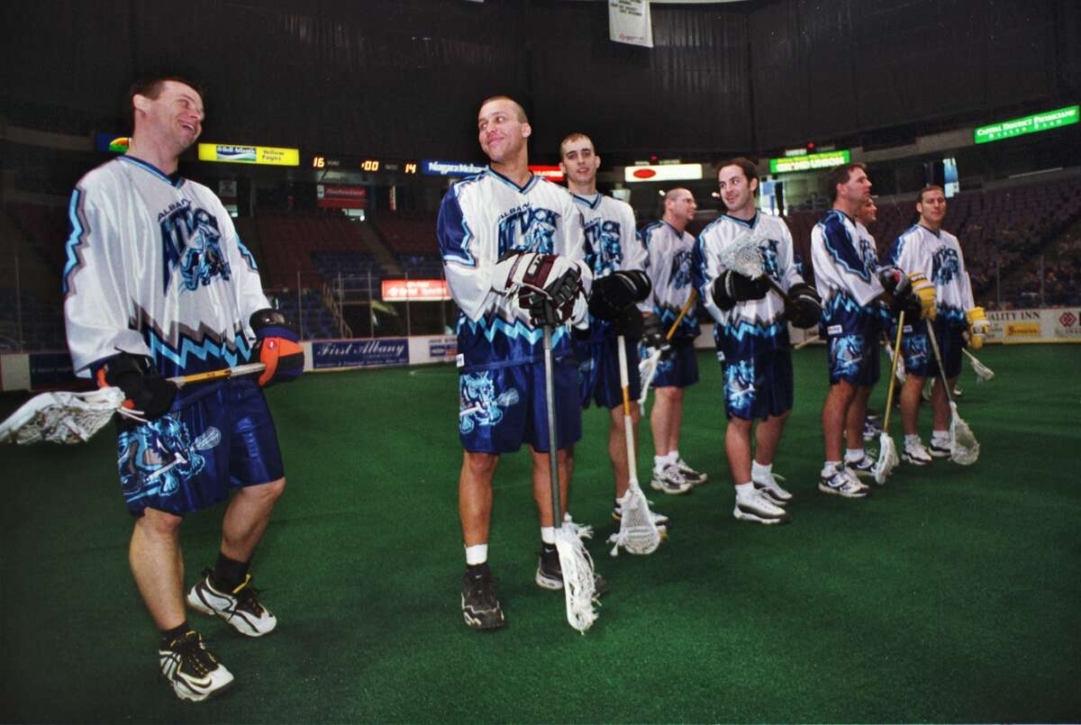 Times Union Staff Photograph by Philip Kamrass -- Members of the Albany Attack share a laugh while lining up for introductions on the field of the Pepsi Arena in Albany during Sunday's Fan Fest for the new pro indoor lacrosse team December 12, 1999.