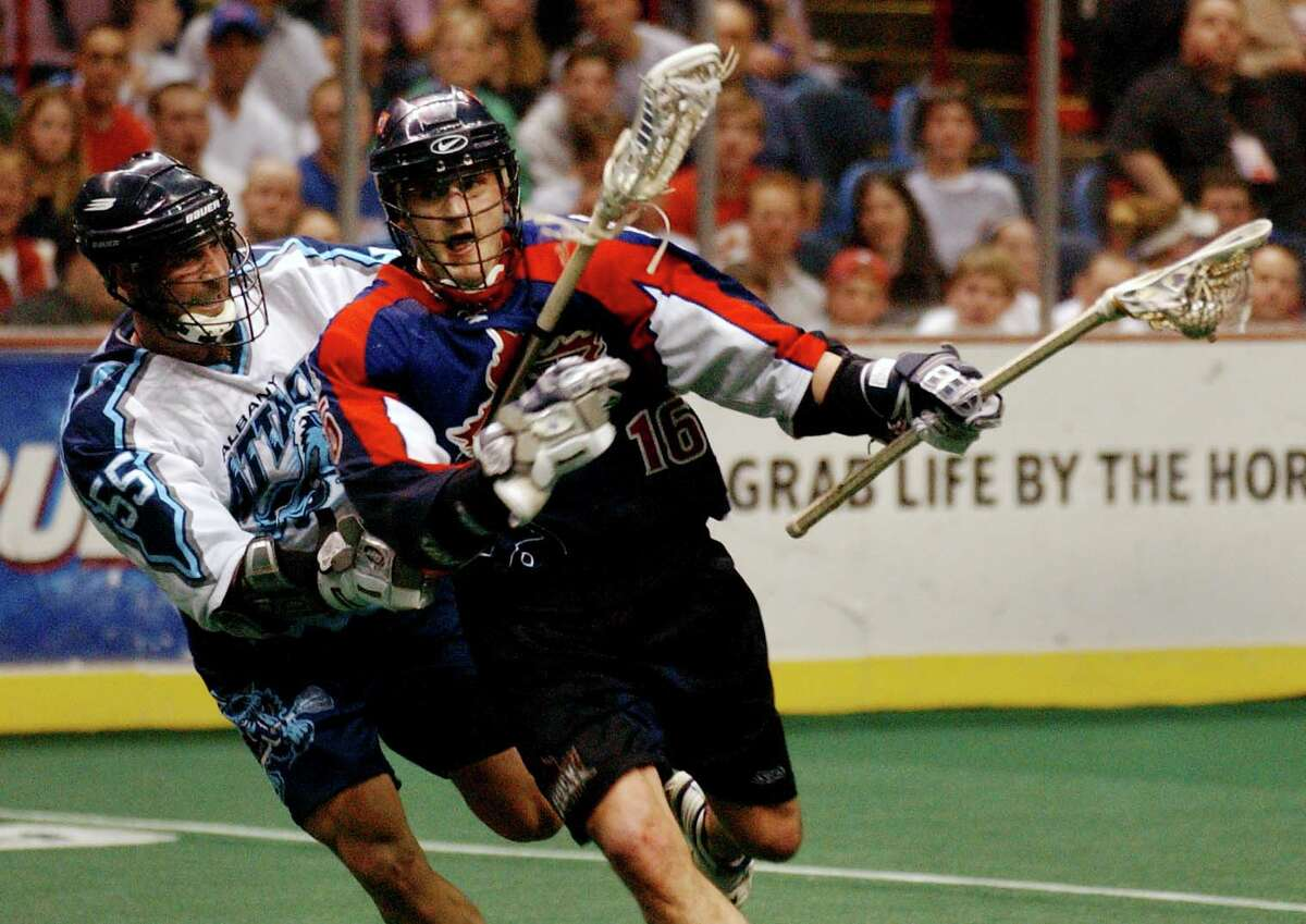 Times Union Staff Photo by Jonathan Fickies -- Albany Attack's Jim Moss tries to stop the Toronto Rock's Blaine Manning in the second half of Saturday's lacrosse championship at the Pepsi Arena Saturday, April 13, 2002.