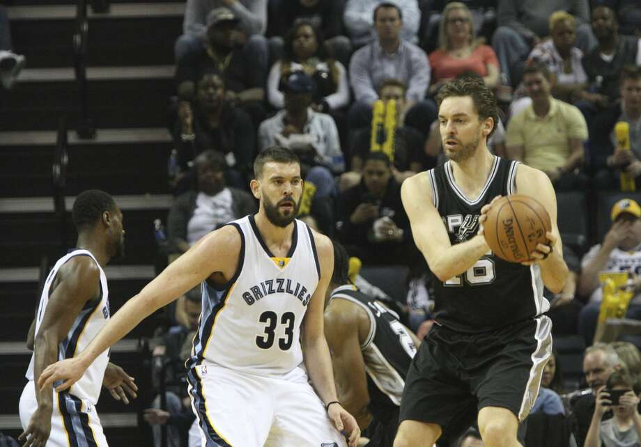 San Antonio Spurs' Pau Gasol (16) plays against his brother, Memphis Grizzlies' Marc Gasol (33) ,in the first half of an NBA basketball game Saturday, March 18, 2017, in Memphis, Tenn. (AP Photo/Karen Pulfer Focht) Photo: Karen Pulfer Focht/Associated Press