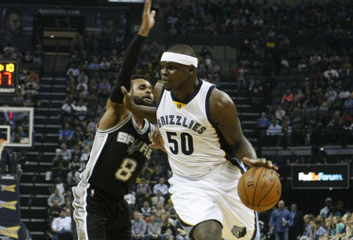 San Antonio Spurs' Patty Mills (8) defends against Memphis Grizzlies' Zach Randolph (50) in the first half of an NBA basketball game Saturday, March 18, 2017, in Memphis, Tenn. (AP Photo/Karen Pulfer Focht)