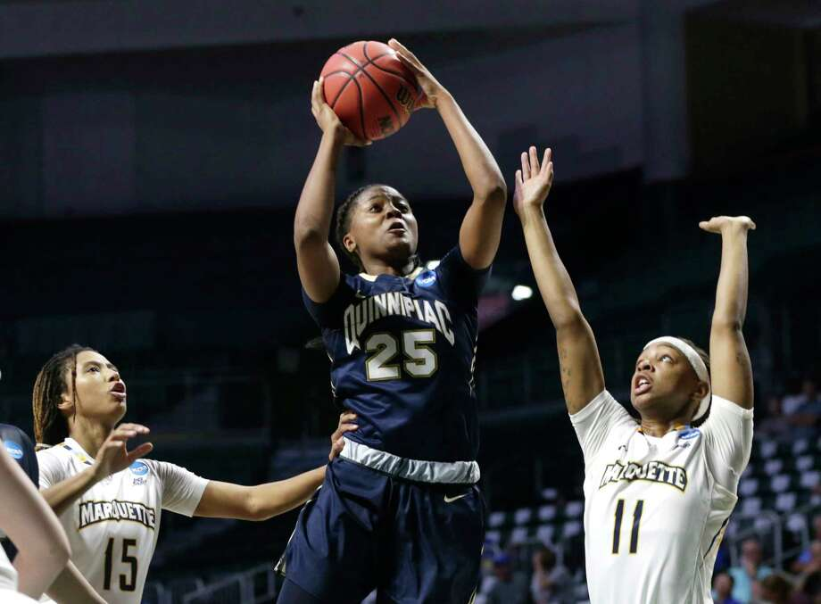 Quinnipiac's Aryn McClure (25) drives to the basket as Marquette's Amani Wilborn (15) and Marquette's Allazia Blockton (11) defend during the second half of a first round game in the NCAA women's college basketball tournament, Saturday, March 18, 2017, in Coral Gables, Fla. Quinnipiac won 68-65. (AP Photo/Lynne Sladky) ORG XMIT: FLLS111 Photo: Lynne Sladky / Copyright 2017 The Associated Press. All rights reserved.