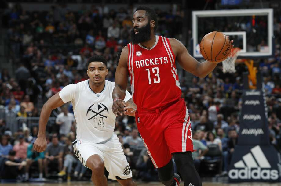 Houston Rockets guard James Harden, front, looks to pass the ball as Denver Nuggets guard Gary Harris pursues in the first half of an NBA basketball game Saturday, March 18, 2017, in Denver. (AP Photo/David Zalubowski) Photo: David Zalubowski/Associated Press