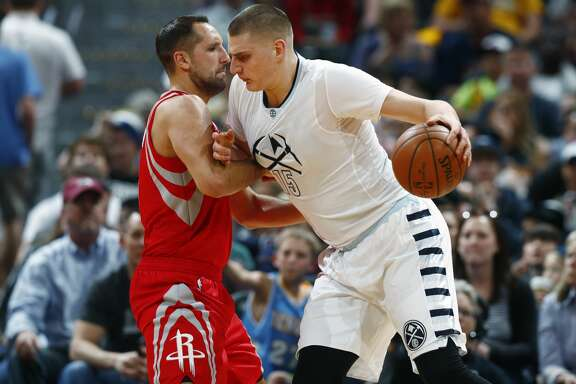 Denver Nuggets forward Nikola Jokic, right, of Serbia, rams into Houston Rockets forward Ryan Anderson and draws a foul in the first half of an NBA basketball game Saturday, March 18, 2017, in Denver. (AP Photo/David Zalubowski)