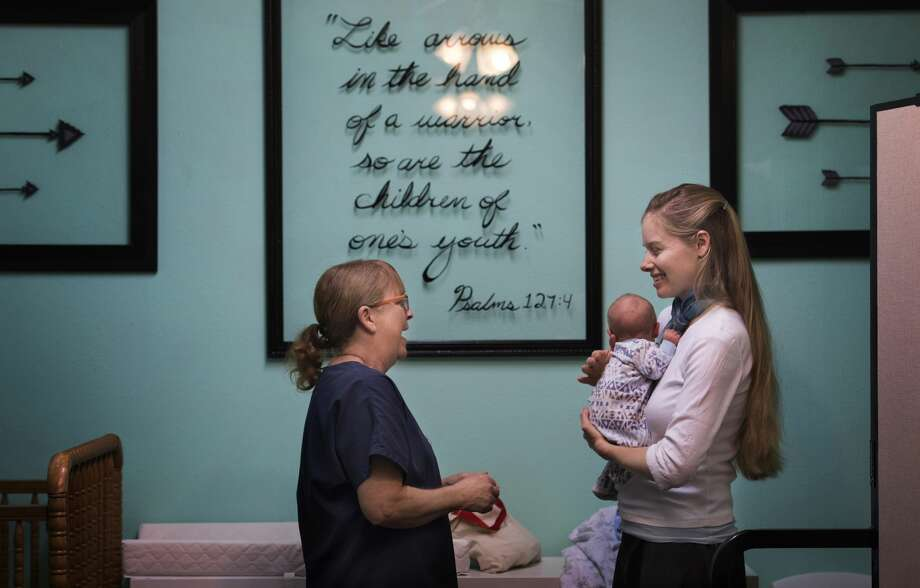 Tamara Estes chats with Karisa Bean in the nursery at Grace Bible Church in Sanger, Texas, on Feb. 19. Photo: Linda Davidson/The Washington Post