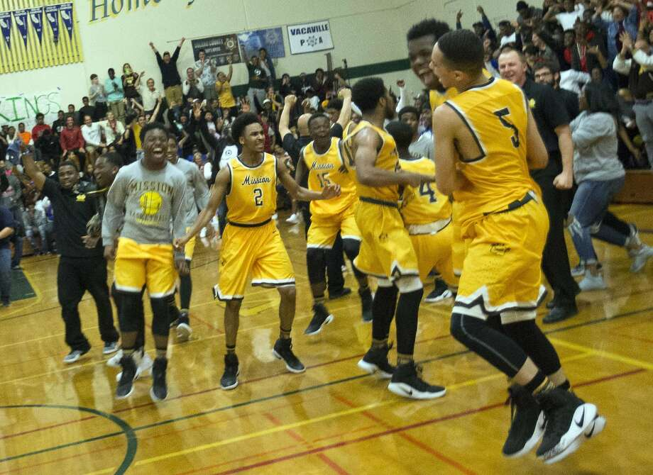 Mission players exult after the beating host Vanden-Fairfield, 72-68, in Saturday's NorCal Division 3 championship game. Photo: D. Ross Cameron, Special To The Chronicle