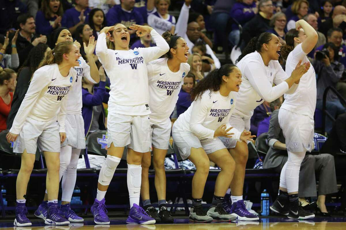 The University of Washington bench cheers during a first-round NCAA tournament game between the Huskies and Montana State, Saturday, March 18, 2017 at Alaska Airlines Arena.