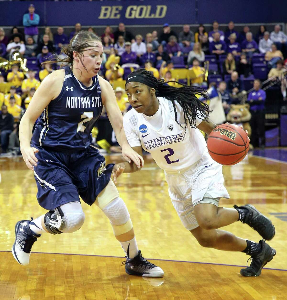 UW's Aarion McDonald, right, drives past Montana State's Peyton Ferris.