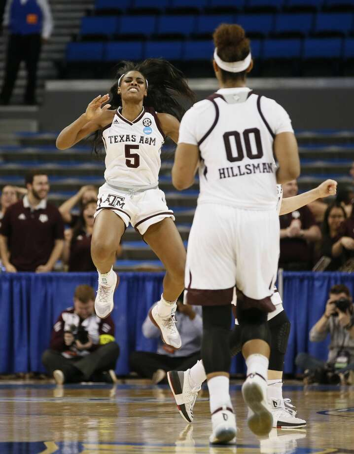 Texas A&M forward Anriel Howard, left, celebrates towards Texas A&M center Khaalia Hillsman after Penn made a turnover late in the second half of a first-round game in the NCAA women's college basketball tournament, Saturday, March 18, 2017, in Los Angeles. Texas A&M won 63-61. (AP Photo/Danny Moloshok) Photo: Danny Moloshok/Associated Press