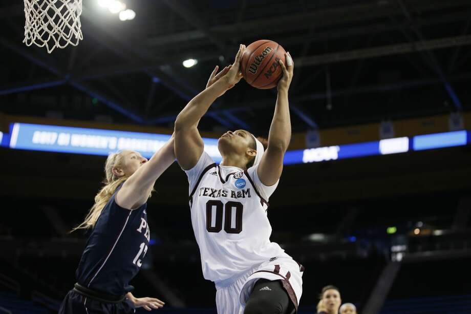 Texas A&M Aggies center Khaalia Hillsman shoots over Penn center Sydney Stipanovich during the first half of a first-round game in the NCAA women's college basketball tournament, Saturday, March 18, 2017, in Los Angeles. (AP Photo/Danny Moloshok) Photo: Danny Moloshok/Associated Press