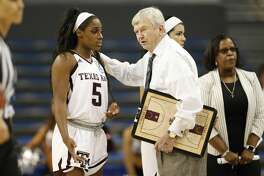 Texas A&M forward Anriel Howard, left, talks with head coach Gary Blair, right, during the second half of a first-round game against Penn in the NCAA women's college basketball tournament, Saturday, March 18, 2017, in Los Angeles. Texas A&M won 63-61. (AP Photo/Danny Moloshok)