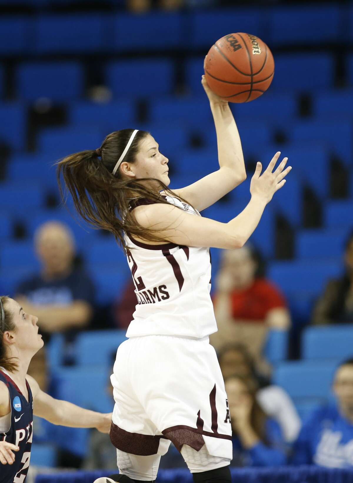Texas A&M guard Danni Williams passes the ball against Penn during the first half of a first-round game in the NCAA women's college basketball tournament, Saturday, March 18, 2017, in Los Angeles. (AP Photo/Danny Moloshok)