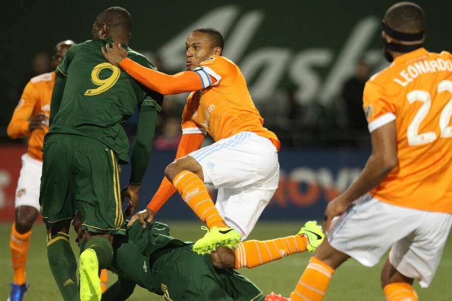 Houston Dynamo midfielder Ricardo Clark crashes through several Portland Timbers during the first half of an MLS soccer match Saturday, March 18, 2017, in Portland, Ore. (Pete Christopher/The Oregonian via AP)/The Oregonian via AP) Photo: Pete Christopher/Associated Press