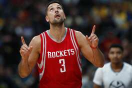 Houston Rockets forward Ryan Anderson reacts after hitting a 3-point basket against the Denver Nuggets during the second half of an NBA basketball game Saturday, March 18, 2017, in Denver. The Rockets won 109-105. (AP Photo/David Zalubowski)