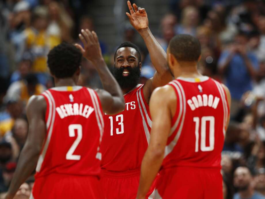 Houston Rockets guard James Harden, center, is congratulated after drawing a foul, by guard Patrick Beverley, left, and guard Eric Gordon during the second half of the team's NBA basketball game against the Denver Nuggets on Saturday, March 18, 2017, in Denver. The Rockets won 109-105. (AP Photo/David Zalubowski) Photo: David Zalubowski/Associated Press