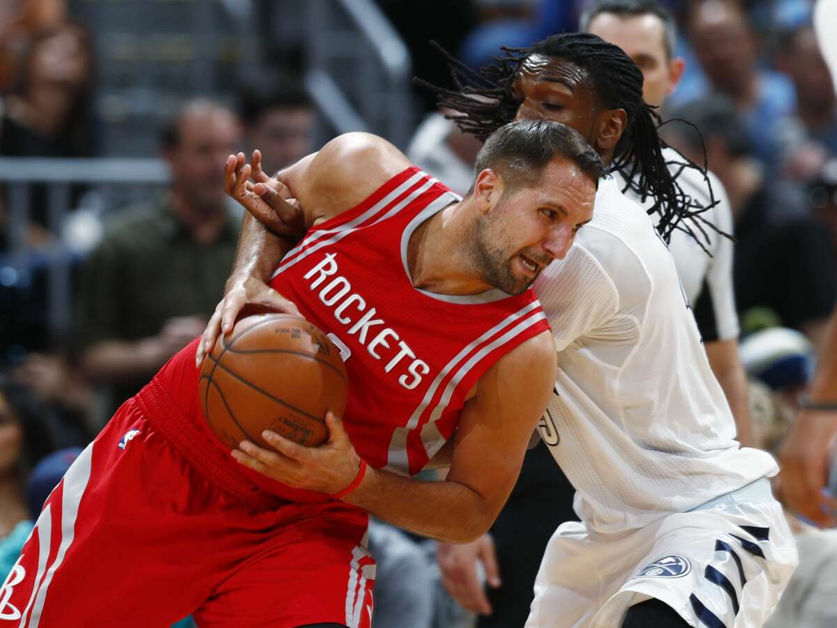 Houston Rockets forward Ryan Anderson, front, drives past Denver Nuggets forward Kenneth Faried during the second half of an NBA basketball game Saturday, March 18, 2017, in Denver. The Rockets won 109-105. (AP Photo/David Zalubowski)