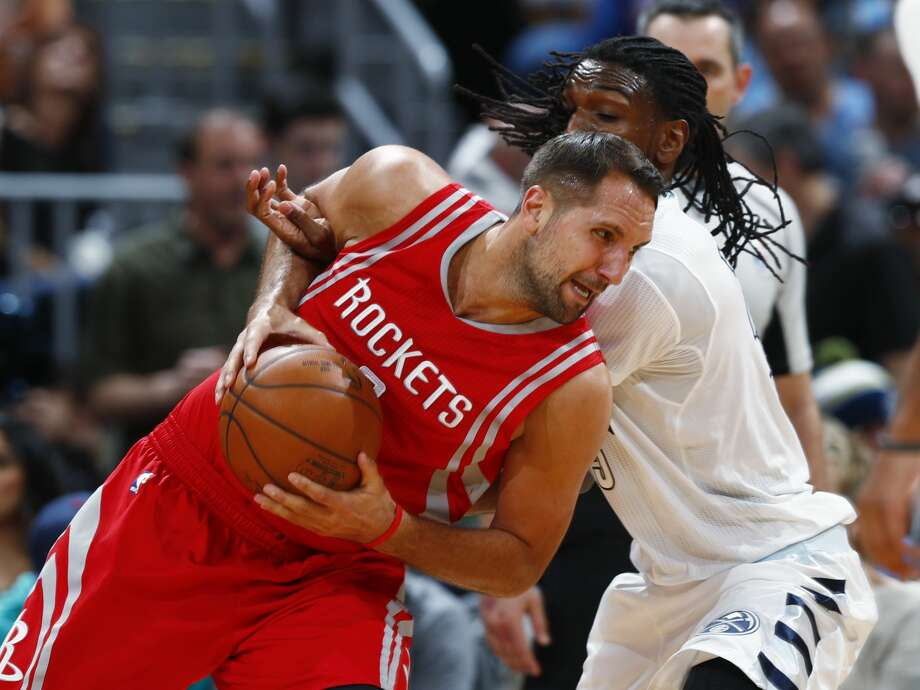 Houston Rockets forward Ryan Anderson, front, drives past Denver Nuggets forward Kenneth Faried during the second half of an NBA basketball game Saturday, March 18, 2017, in Denver. The Rockets won 109-105. (AP Photo/David Zalubowski) Photo: David Zalubowski/Associated Press