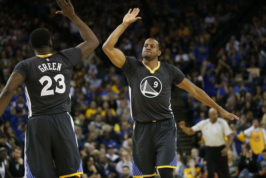 Andre Iguodala (9) of the Golden State Warriors high-fives teammate Draymond Green (23) after making a dunk during third quarter of their NBA basketball game against the Milwaukee Bucks at Oracle Arena in Oakland, Calif. on Saturday, March 18, 2017. The Warriors defeated the Bucks 117-92. Photo: Stephen Lam, Special To The Chronicle