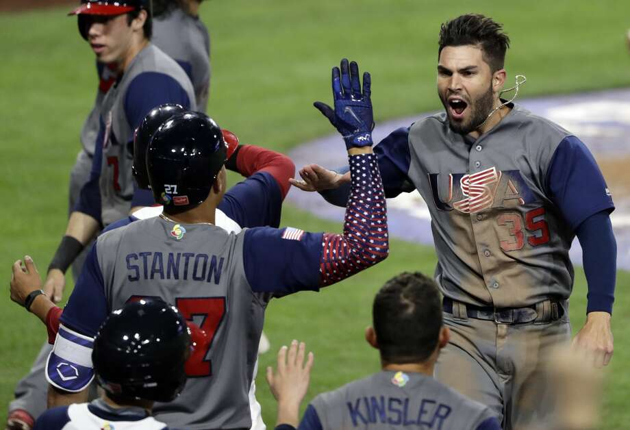 United States' Eric Hosmer (35) celebrates with teammates after scoring on a two-run double by Andrew McCutchen during the eighth inning of a second-round World Baseball Classic baseball game against the Dominican Republic on Saturday, March 18, 2017, in San Diego. (AP Photo/Gregory Bull) Photo: Gregory Bull/Associated Press