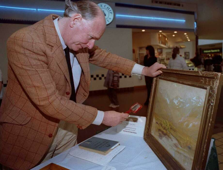 Jay St. Mark evaluates a painting during appraisal day at the Danbury Fair Mall. The event was sponsored by the Museum and Historical Society. Photo: File Photo\Wendy Carlson / File Photo\Wendy Carlson / The News-Times File Photo