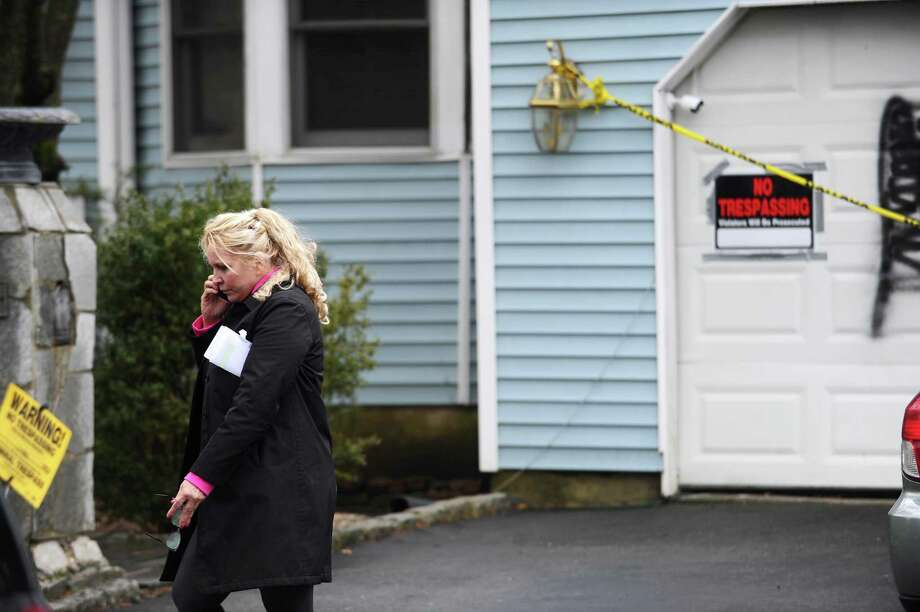 Heather Lindsay speaks on the phone in front of her garage, which was vandalized for the second time in Stamford, Conn. on Wednesday, March 1, 2017. Photo: Michael Cummo / Hearst Connecticut Media / Stamford Advocate
