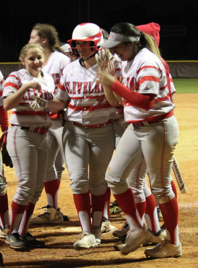 The Lady Indians gather around Chelsea McNorton (22) to congratulate her for making a home run. Photo: Jacob McAdams