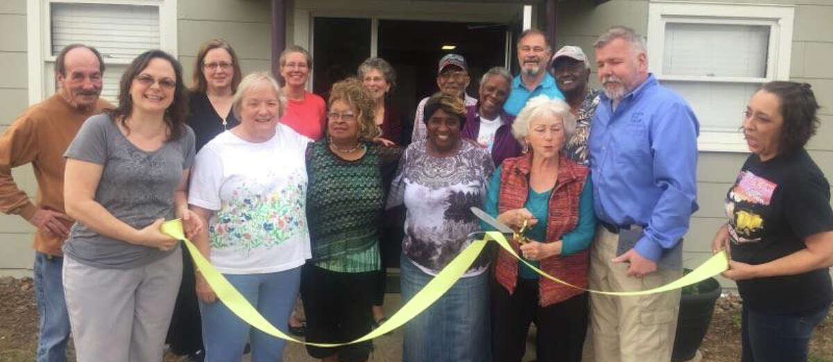 San Jacinto County Democratic Party Vice President Cora Tullar cuts the ribbon to welcome the organization into the Coldspring/San Jacinto County Chamber of Commerce on March 16.