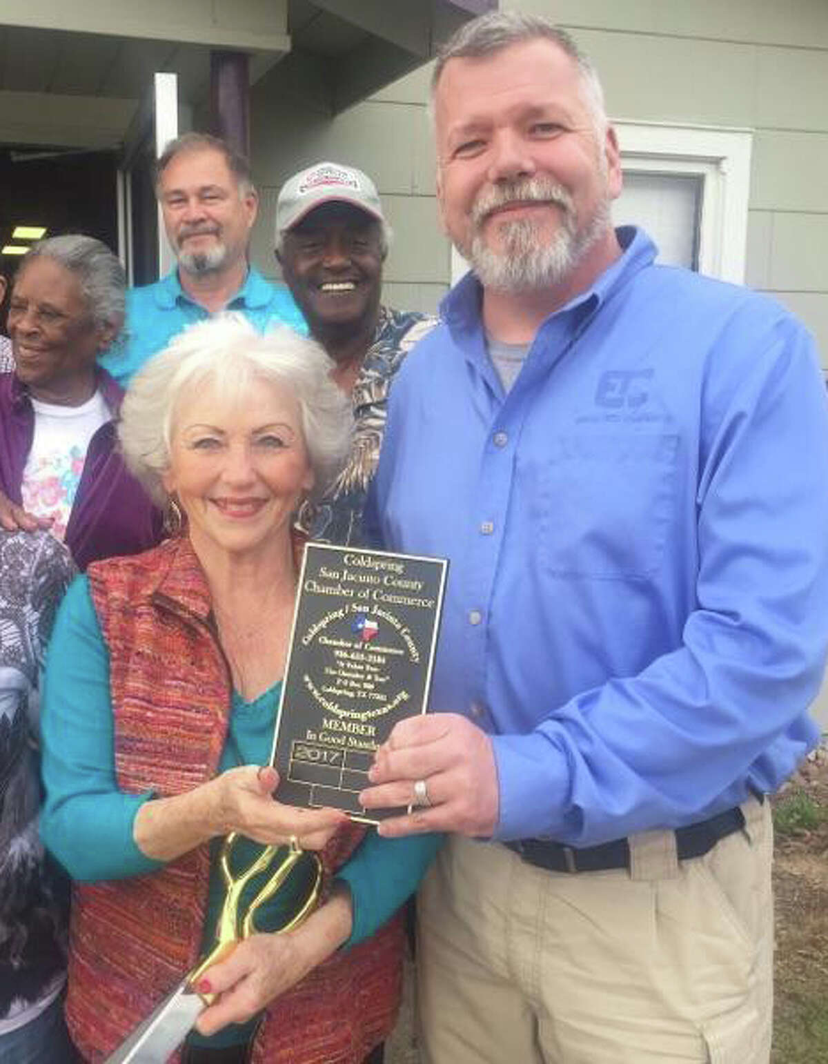 Coldspring/San Jacinto County Chamber of Commerce President Pat Clark (right) presents a plaque to commemorate the welcoming of the San Jacinto County Democratic Party to its Vice President Cora Tullar (left).