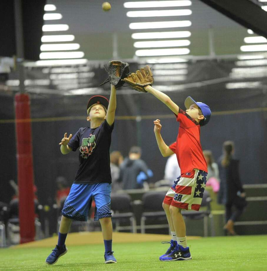 Matthew Goodman, 11, of Stamford and Georgie Childs, 11, of Darien participate in a baseball skills clinic at the new Bobby Valentine's Sports Academy complex in Stamford, Conn. on March 17, 2017. The newly opened State of the Art indoor baseball teaching facility accommodates a full size Major League infield diamond, batting and pitching cages, as well as a workout weight room and gym. Photo: Matthew Brown / Hearst Connecticut Media / Stamford Advocate
