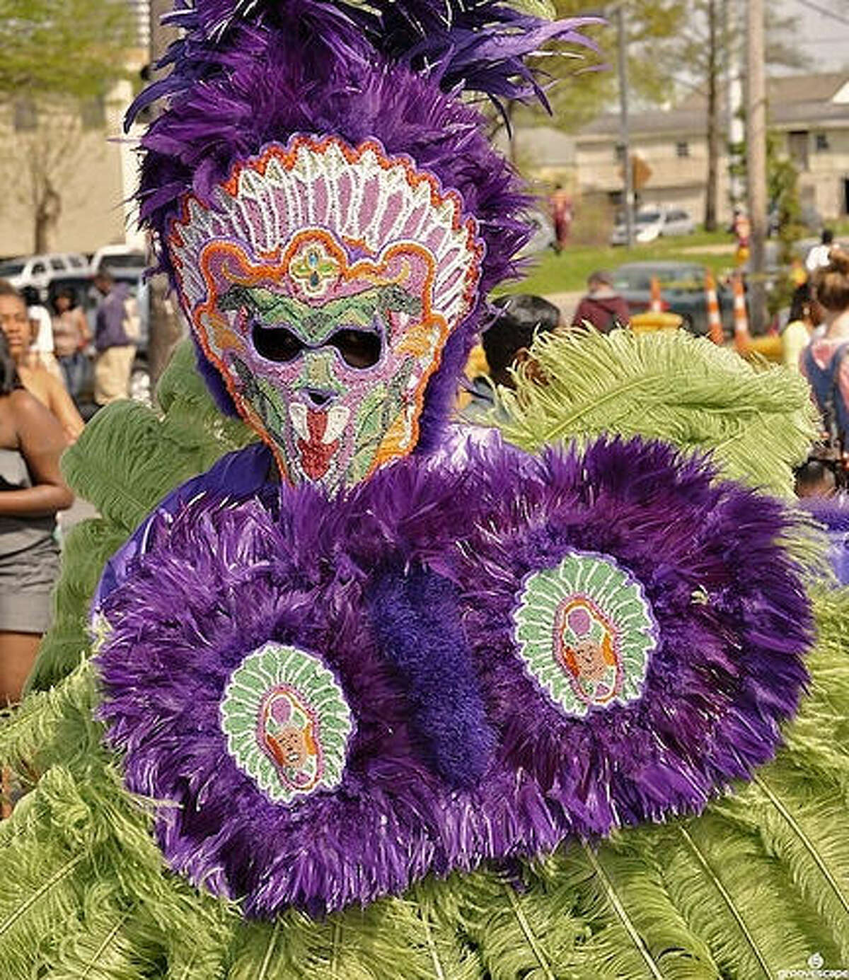 Mardi Gras Indians hand make their costumes from beads and feathers. They only wear the elaborate suits rarely - for Mardi Gras and Super Sunday. The second of these occasions is the Sunday closest to St. Joseph's Day in the heavily Catholic city of New Orleans. The Indians parade, dance, sing and meet up to see who has the best and prettiest costume among all the tribes.
