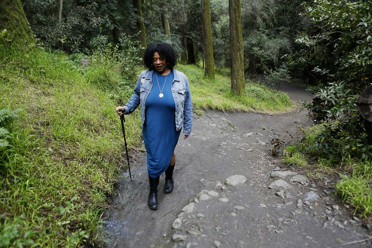 Rue Mapp, founder of Outdoor Afro, walks along a trail inside Joaquin Miller Park in Oakland on March 19, 2017.