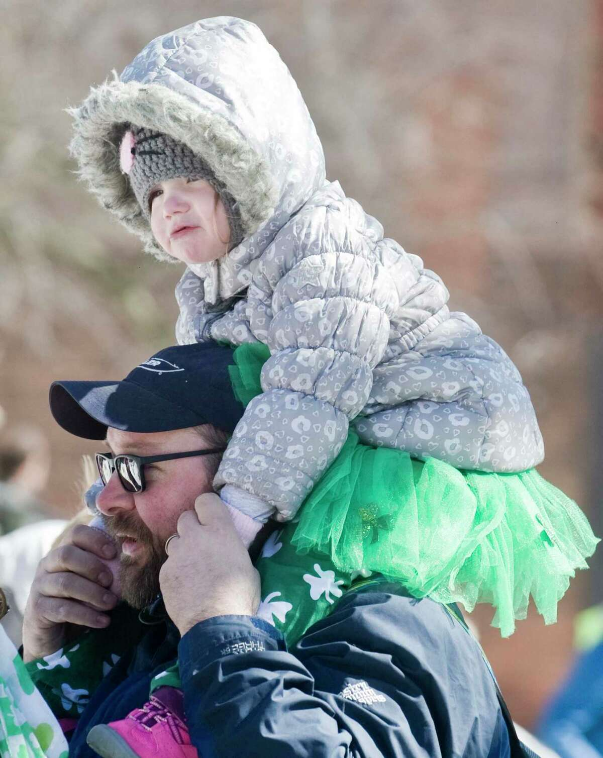 Brett Lynas, of New Fairfield, watching the marching groups with his daughter Madigan, 2, at the Greater Danbury Irish Cultural Center's St. Patrick's Day parade on Main Street in Danbury. Sunday, March 19, 2017