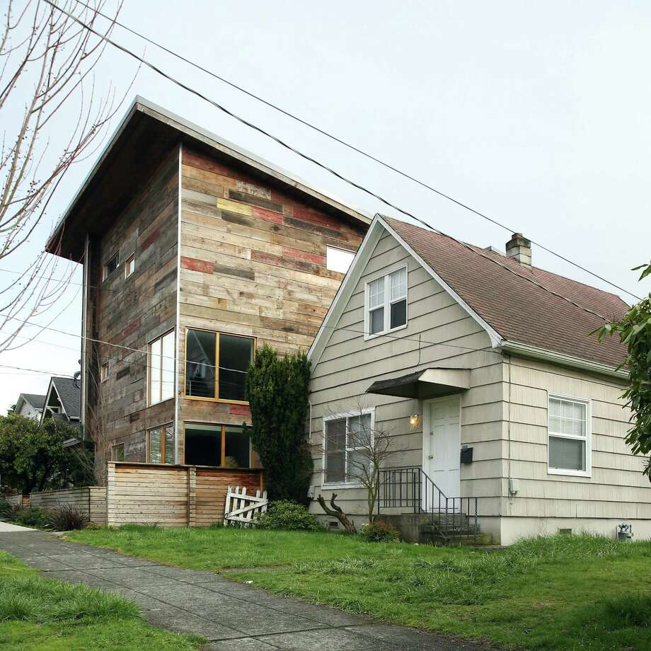 "Seattle's changing a lot these days (pictured above: A two-bedroom house built in 1900 next to a modern three-bedroom built in 2015 on NW 61st Street in Ballard). But the quintessential ""Seattle style"" has had some mainstays over the years. (Genna Martin, seattlepi.com) Photo: GENNA MARTIN/SEATTLEPI.COM / SEATTLEPI.COM"