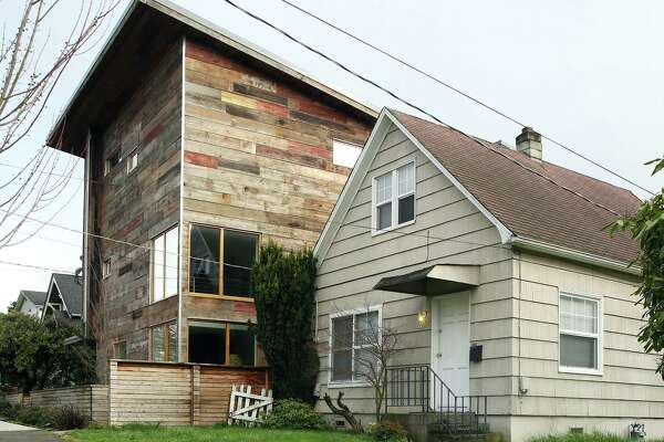 A two-bedroom house built in 1900 next to a modern three-bedroom built in 2015 on NW 61st Street in Ballard.(Genna Martin, seattlepi.com)