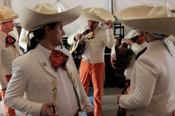 Mariachi band members from Dallas wait to take to the stage during the Mariachi Invitation semifinals during Go Tejano Day at the Houston Livestock Show and Rodeo on Sunday, March 19, 2017.