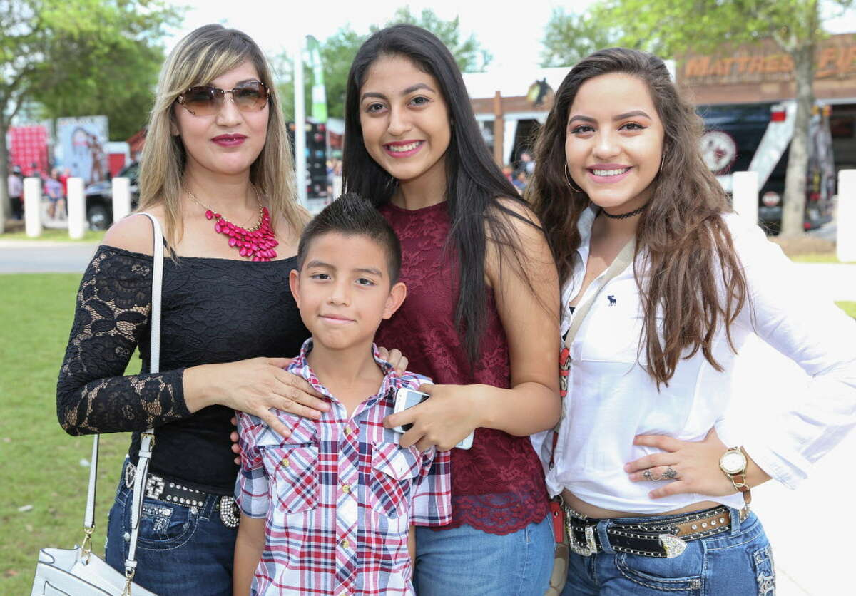 Fans of Houston Livestock Show & Rodeo and Banda El Recodo and Siggno pose for a photo before the show Sunday, March 19, 2017, in Houston.