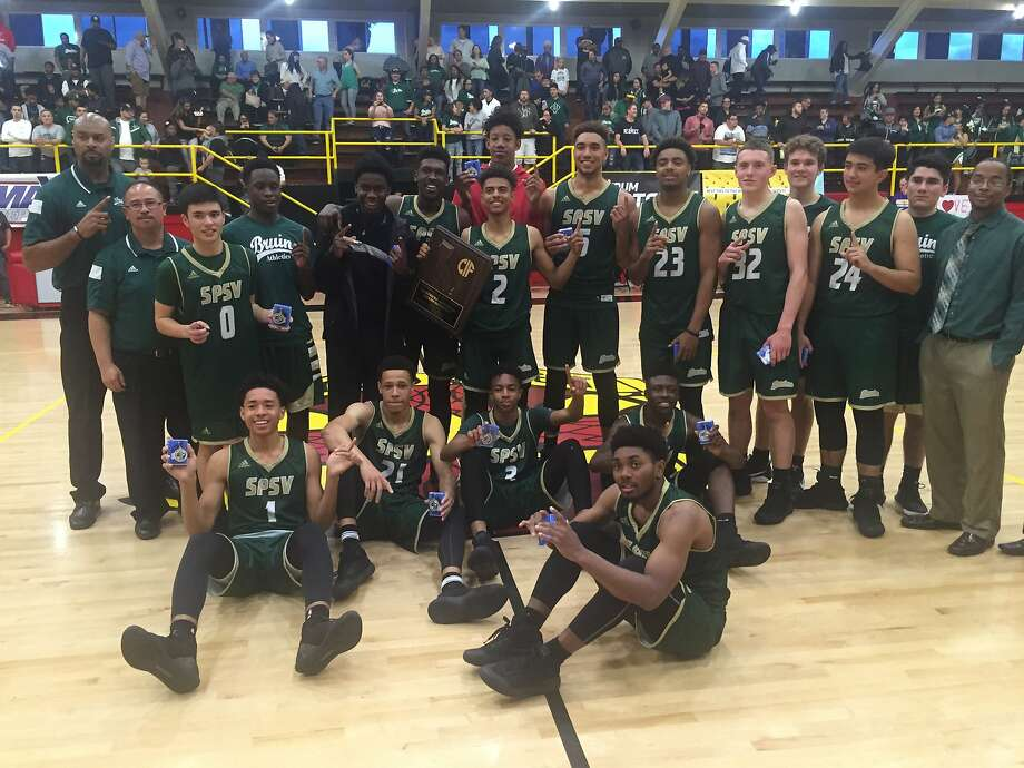 St. Patrick-St. Vincent-Vallejo players and coaches pose with their medals after winning the Northern California Division 4 title on Saturday night. The Bruins beat Palma-Salinas, 73-48. Photo: Mike Lerseth, The Chronicle