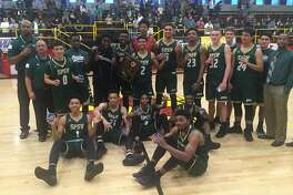 St. Patrick-St. Vincent-Vallejo players and coaches pose with their medals after winning the Northern California Division 4 title on Saturday night. The Bruins beat Palma-Salinas, 73-48.