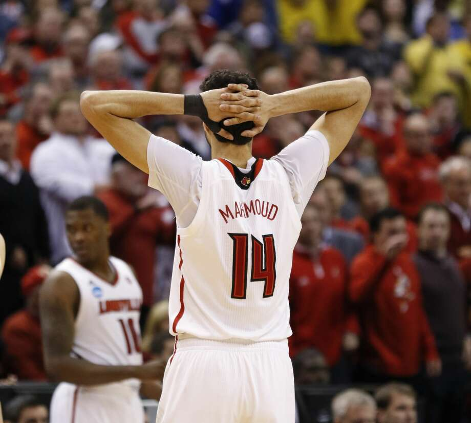 Louisville Cardinals forward Anas Mahmoud (14) reacts late in the game against Michigan in the second round of the NCAA men's college basketball tournament on Sunday, March 19, 2017, in Indianapolis, Ind. Second seed Louisville lost to seventh seed Michigan 73-69. (Sam Riche/TNS) Photo: Sam Riche/TNS
