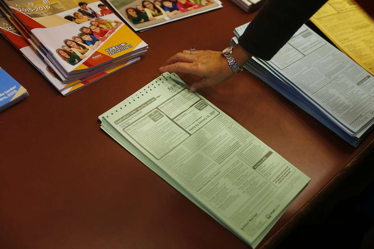 An application form is picked up from a stack at the San Francisco Unified School District office on the last day to hand in applications for round 1 for the upcoming school year on Friday, January 16, 2015 in San Francisco, Calif.