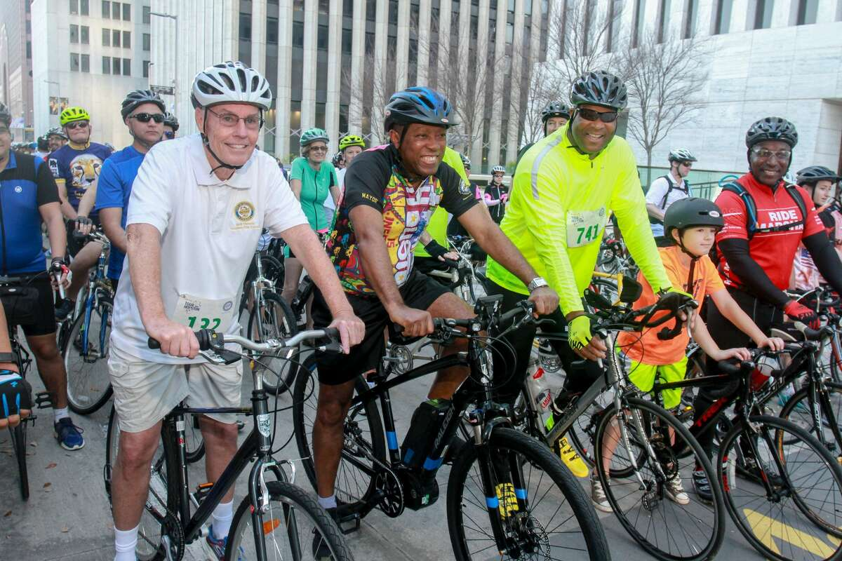 Council member Jack Christie, from left, Mayor Sylvester Turner, and Council member Dwight Boykins prepare to start one of the waves at the Tour de Houston, the city's annual fundraising bike ride. The ride is presented by Apache Corporation and benefits the Re-Plant Houston Program. (For the Chronicle/Gary Fountain, March 19, 2017)
