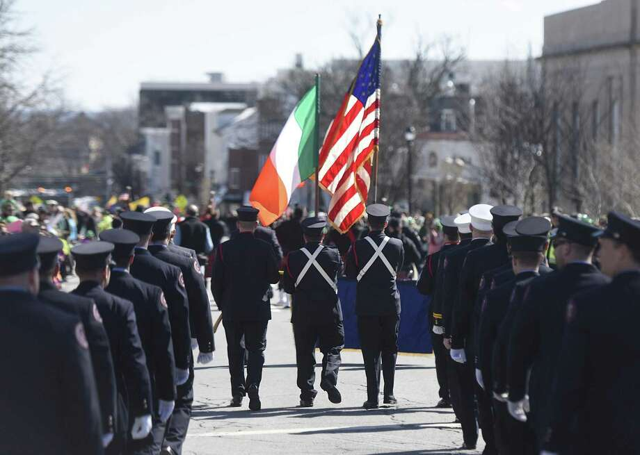 Greenwich Firefighters Association members hold the Irish and American flags while marching in the Greenwich St. Patrick's Day Parade down Greenwich Avenue in Greenwich, Conn. Sunday, March 19, 2017. Presented by the Greenwich Hibernian Association, the parade featured Irish bagpipe music, Irish dancers, floats from many local organizations, as well as Greenwich police, fire and EMS. Photo: Tyler Sizemore / Hearst Connecticut Media / Greenwich Time