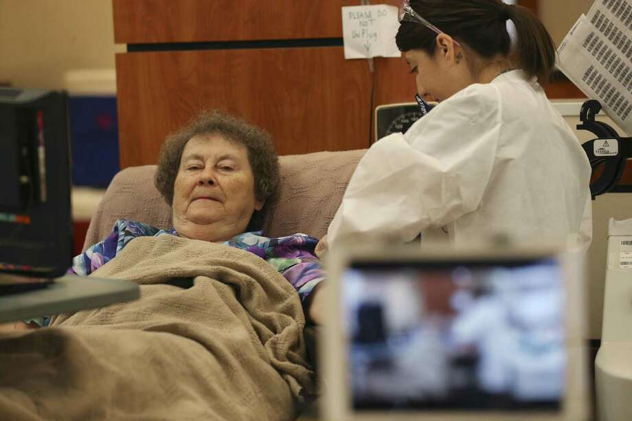 Sister Anna Marie Vrazel, a nun with the Sisters of Divine Providence, donates blood at the South Texas Blood & Tissue Center, Monday, Feb. 20, 2017. Inspired by her father, Vrazel has donated blood since 1969. Helping her is Krystal Garza. Vrazel is a member of the 40 gallon club and with her latest donation made it to 41gallons. Photo: JERRY LARA, Staff / San Antonio Express-News / © 2017 San Antonio Express-News