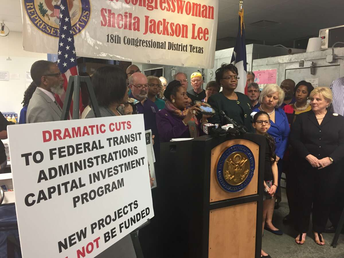 U.S Rep. Sheila Jackson Lee holds up a meal distributed by Meals on Wheels at a press conference Sunday to condemn proposed budget cuts to a host of federally funded community support programs.