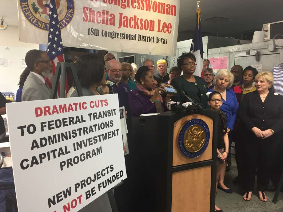 U.S Rep. Sheila Jackson Lee holds up a meal distributed by Meals on Wheels at a press conference Sunday to condemn proposed budget cuts to a host of federally funded community support programs. Photo: Dylan Baddour