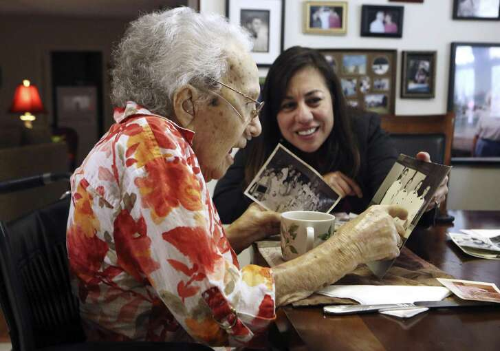 Lucy Coffey and Queta Rodriguez go through pictures taken while Coffey was in Japan. Coffey is the nation's oldest woman veteran, serving in the procurement office of the Women's Army Auxiliary Corps during World War II. Today, she is 108 years old. A group in Austin wants to send her to Washington for an honor flight and possibly meet with Vice President Biden. Coffey enlisted in the Women's Army Auxiliary Corps in 1943 and landed in Japan, where she served in the procurement office and worked for 10 years after the war ended. She worked in the procurement office at Kelly from 1958 until her retirement in 1971, and is only a few days younger than America's oldest male veteran, Richard Overton.